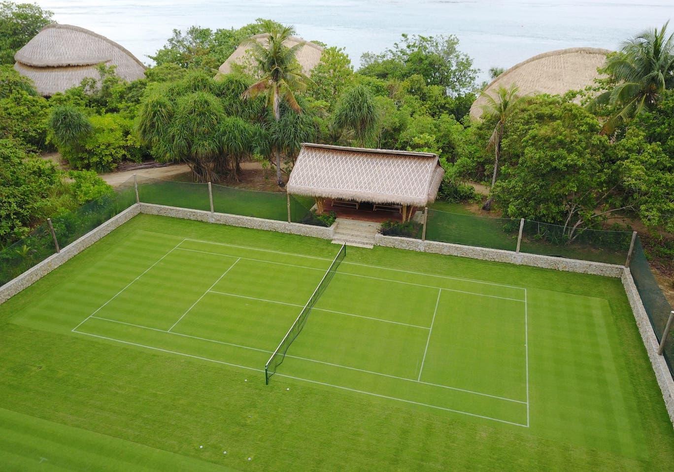 grass tennis court at cempedak